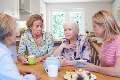 Women Consoling Unhappy Friend At Home